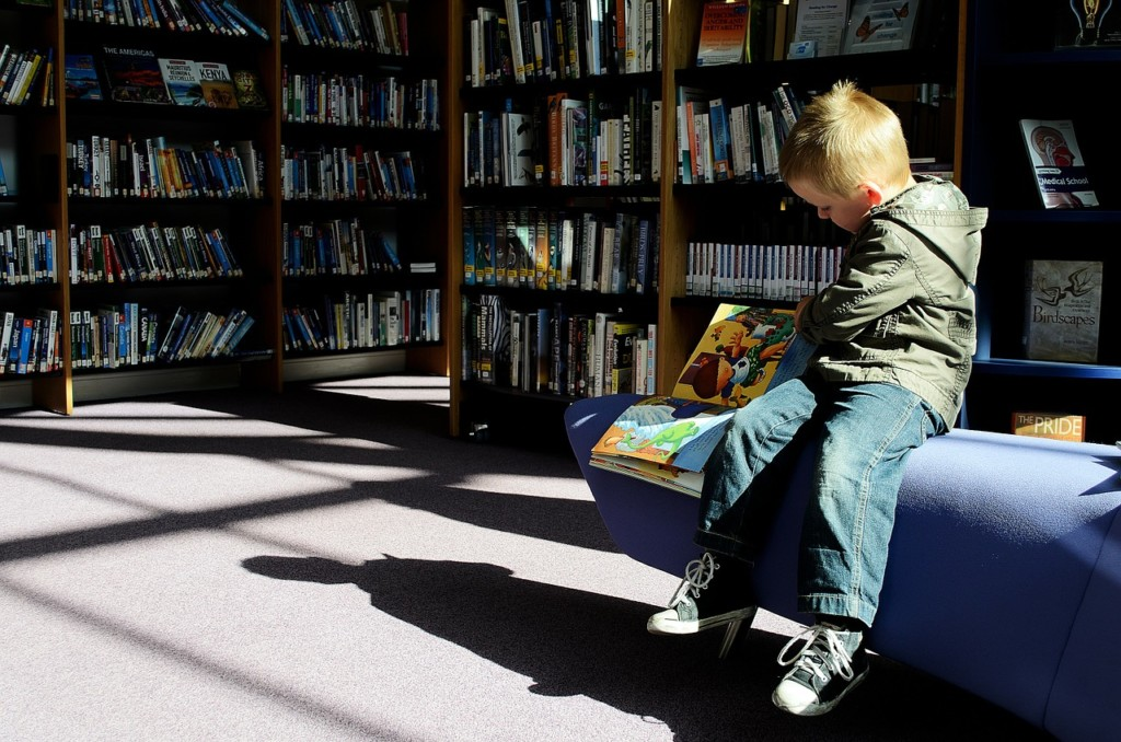 child at library, library