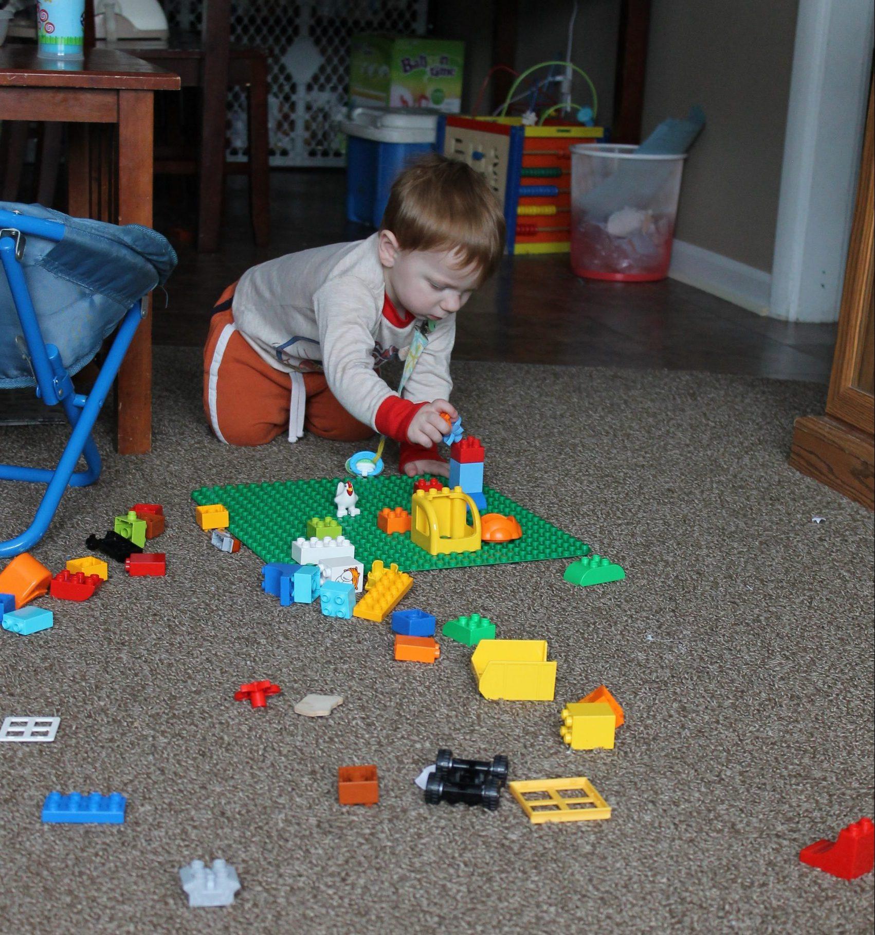 toddler playing with Legos