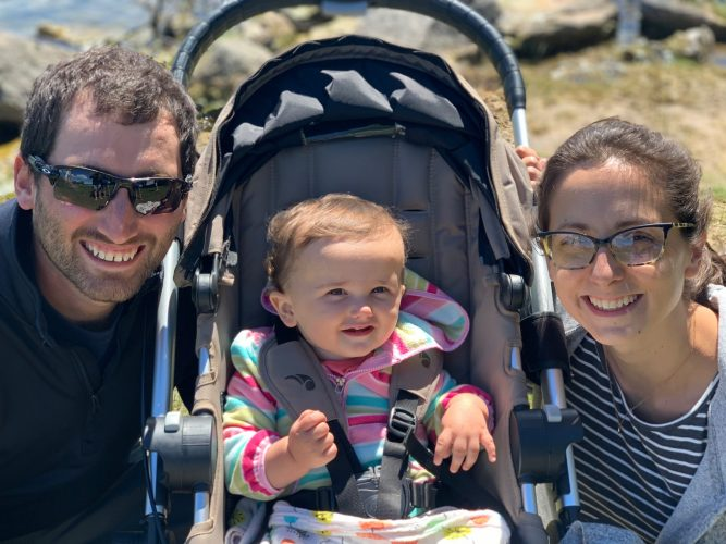 family of three on vacation, baby in stroller
